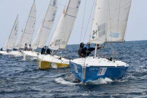 Line of IC24 Sailboats Racing